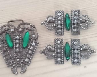 Three vintage steel cut buckles with green rhinestones