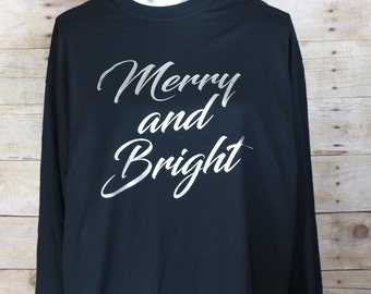 Merry and Bright on Black shirt with Silver writing