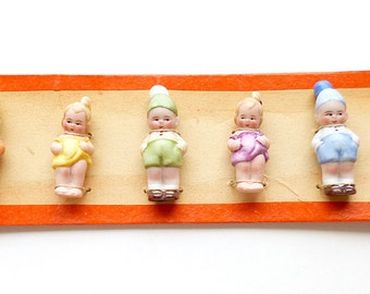 Antique 6 bisque Baby penny Doll on sample card original Hertwig Germany Tiny miniature German porcelain early 1900