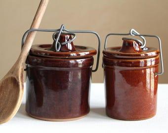 Vintage set of two stoneware crocks with lid / lidded ceramic pot in warm brown tones