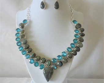A Radiant 565 Carats Blue Topaz and Labradorite Silver Necklace Set****.