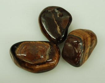 Three Pieces Smooth Tiger Eye Tumble Stone sold by  3 pcs