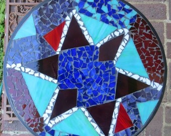 Abstract star stained glass mosaic table. Stained glass mosaic garden table. Mosaic modern art. Stained glass mosaic star table.