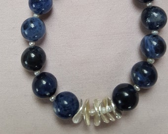 Deep blue Sodalite with beads