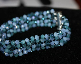 Bangle of beads and crystals in shades of blue
