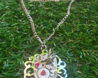 Steampunk silver COG watch mechanism and rabbit necklace