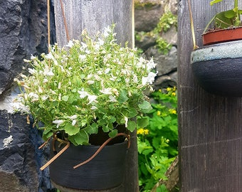 Hanging black stoneware pot