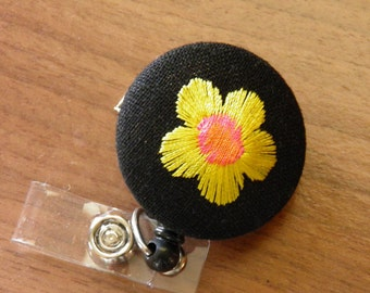 Embroidered flower badge reel