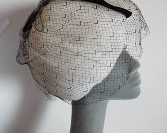 VINTAGE Ladies Hat  1950's Ivory Netting Bulbous Cloche with a black velvet band through back and bow on top with full black veiling