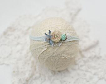 Newborn and sitter tieback in shades of blue and creamy lemon. Newborn, baby headband prop.