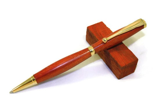 Wooden Twist-Action Ballpoint Pen Made from African Paduak Wood With Gold Fittings.