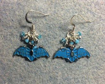 Turquoise enamel bat charm earrings adorned with tiny dangling turquoise and silver Chinese crystal beads.