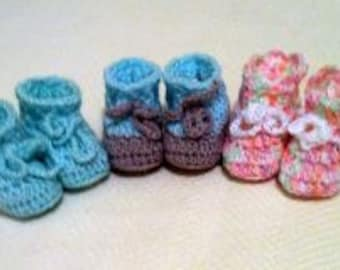 Pattern baby booties . Size:6-9 months.