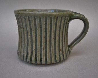 Pottery Wheel Thrown Stoneware Cup Reduction Fired & Hand Carved with Dark Green Celadon Glaze