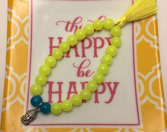 Neon Yellow and Teal Blue beaded flexible bracelet with Silver Buddha Head Charm and Neon Yellow tassel.