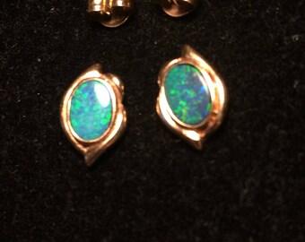 14k yellow gold with dark blue opal earrings