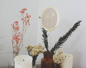 Paper and glittery gold paper table numbers