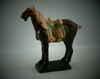Chinese dark brown sancai glaze porceain war horse. Mid-century representation of Tang dynasty tomb figure in 3 colour majolica glaze