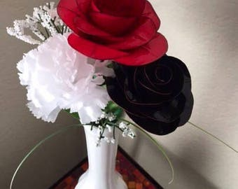 Elegant duct tape roses and fabric carnation in bud vase