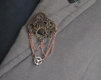 Metal hand sewn steampunk brooch