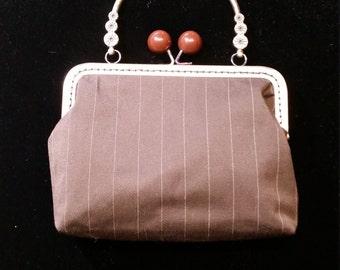 L504.  Clutch bag in brown stripe