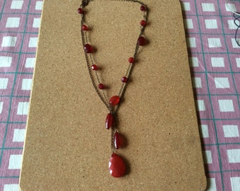 Double chained red plastic necklace