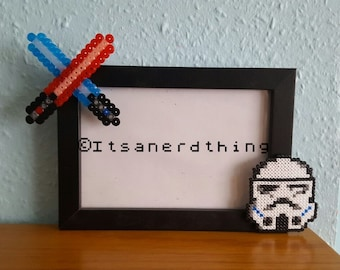 Storm trooper and glow in the dark lightsabers photo / picture frame. Hama / perler beads