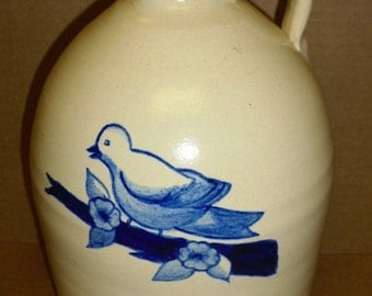 Large old jug with Blue Bird and branch