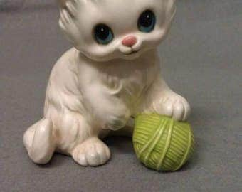 Beige Cat with Grey with Blue Eyes and Pink Nose with Green Ball of Yawn Cat Figurine