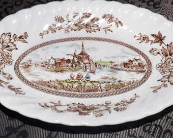 Vintage (c.1960s) Johnson Brothers Tulip Time Multicolor Brown ironstone cranberry dish / gravy under-plate. Windmill, flowers, fluted edge.