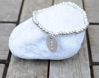 Bracelet plate engraved oval and balls of zamak