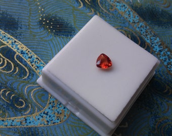 Loose Approximately .75ct 6x6mm Triangle/Trillion Treated Padparadscha Sapphire