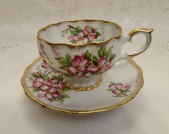 Swirled Lusterware Footed Tea Cup and Saucer with Pink Blossoms and Gold Trim  - Japan