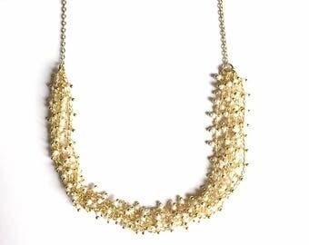 ARGAN - gold and white collar