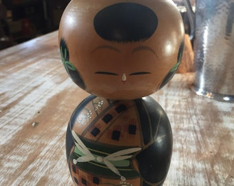 Antique traditional japanese wooden nodder doll