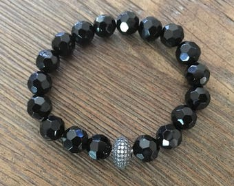 Black Onyx stretch bracelet with a crystal bead accent
