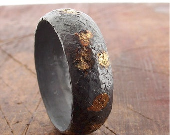Rustic gold and black silver mens wedding band 8mm wide court band with hammered surface.