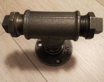 With attached Central's black cast-iron door handle