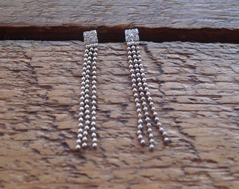 Gorgeous silver and rhinestone drop earrings perfect for the party season, measuring 4.5cm down