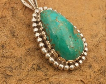 Turquoise Jewelry, Handmade Turquoise pendent, Nevada turquoise, Handmade by Me out of sheet and wire sterling silver,