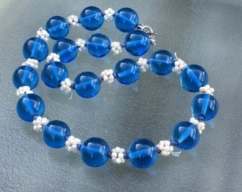 Vintage blue glass choker with pearl clusters and sterling clasp.  Charming!!