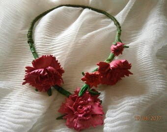 Cloves (Carnations) open necklace along with a bunch of pink carnations almost Carmine.
