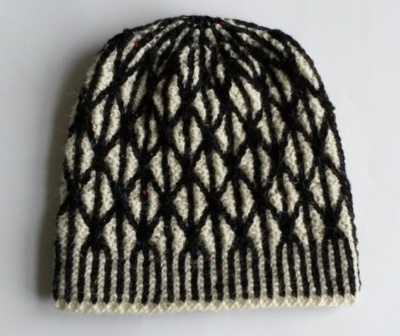 Aran Wool Beanie: beautiful two-tone hat in white wool with black tweed cable pattern. Monochrome hat. Handmade in Ireland with luxury wool.