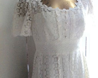 Late 60's /early 70's vintage cotton lace wedding dress,  small 12. Scoop neckline,  short sleeves and high waist. In lovely fresh condition