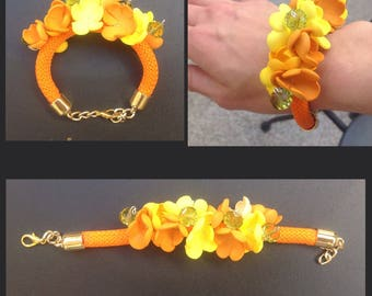 Orange climbing rope bracelet and yellow rubber flowers