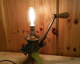 Upcycled vintage meat grinder lamp.
