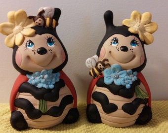 Two ceramic  ladybugs for your colection or garden.