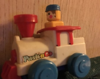 1975 tomy push and go toy