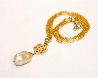 Baroque pearl pendant on a triple chain