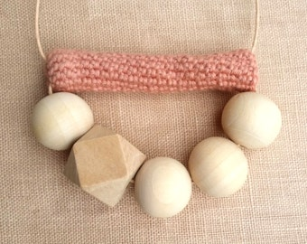 Geometric wooden bead necklace. Crochet necklace. Pink necklace. Half circle necklace. Pendant necklace. Statement necklace. Pastel necklace